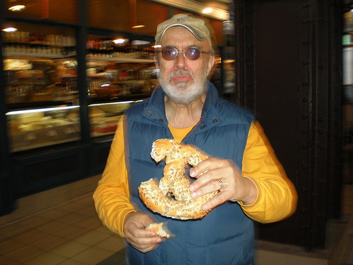 Eating a big pretzel at the Central Market Hall in Budapest.