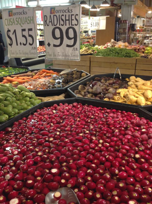 A vat of radishes with a vibrant red color.