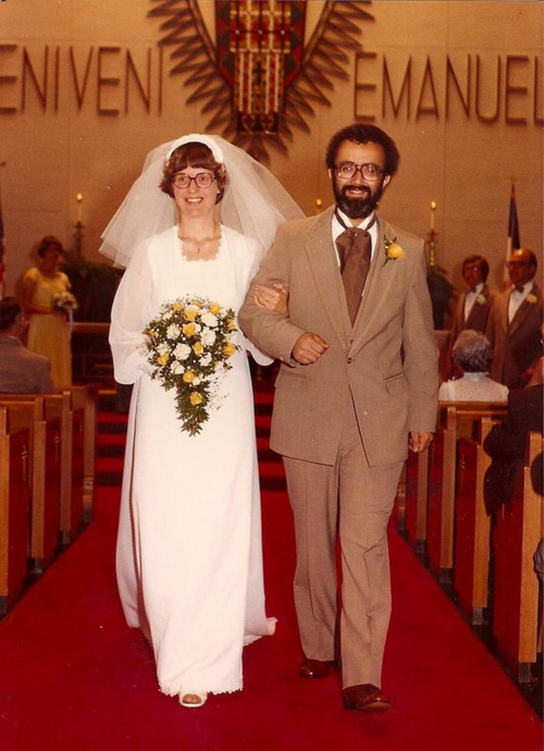A picture of me and my bride walking down the aisle.
