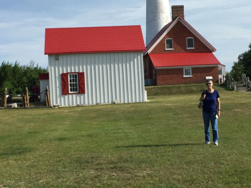 Gladys poses in front of the lighthouse at Tawas.
