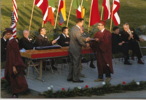 Receiving my high school diploma on graduation day.