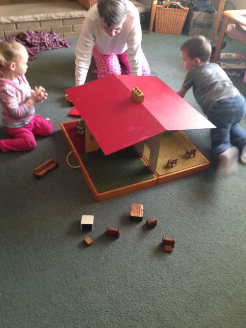 My grandkids play with a doll house made by my Uncle Wes.