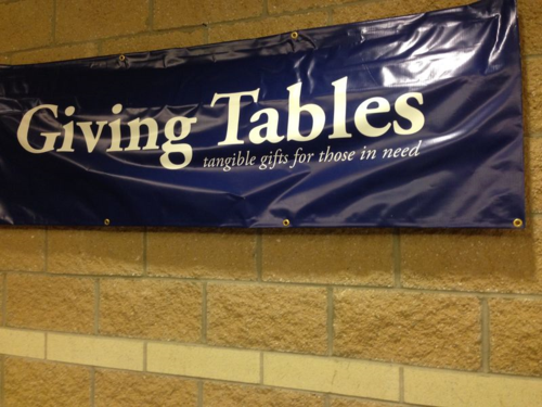 "Sign for the ""Giving Tables"" at Ada Bible Church in west Michigan."