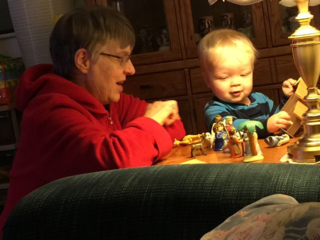 She's playing with our grandson.