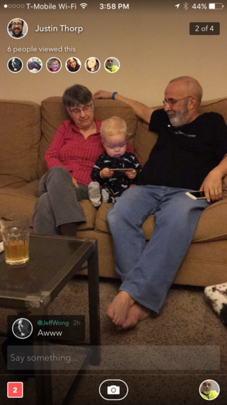 My wife, our youngest grandson and me.