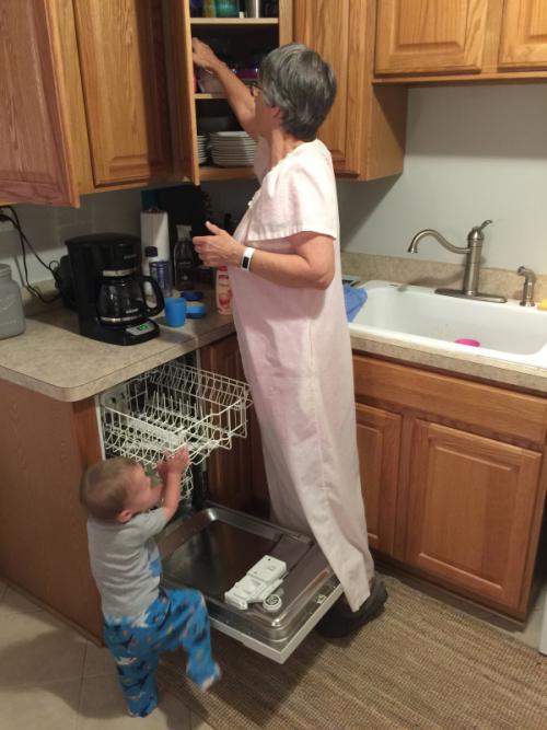 Unloading the dishwasher together.