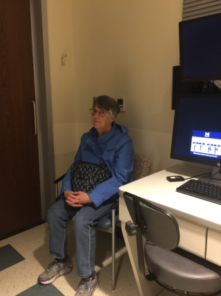 Gladys sits for yet one more eye exam.